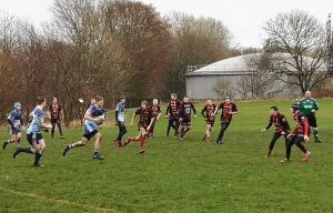 A Wet And Muddy Rugby Game